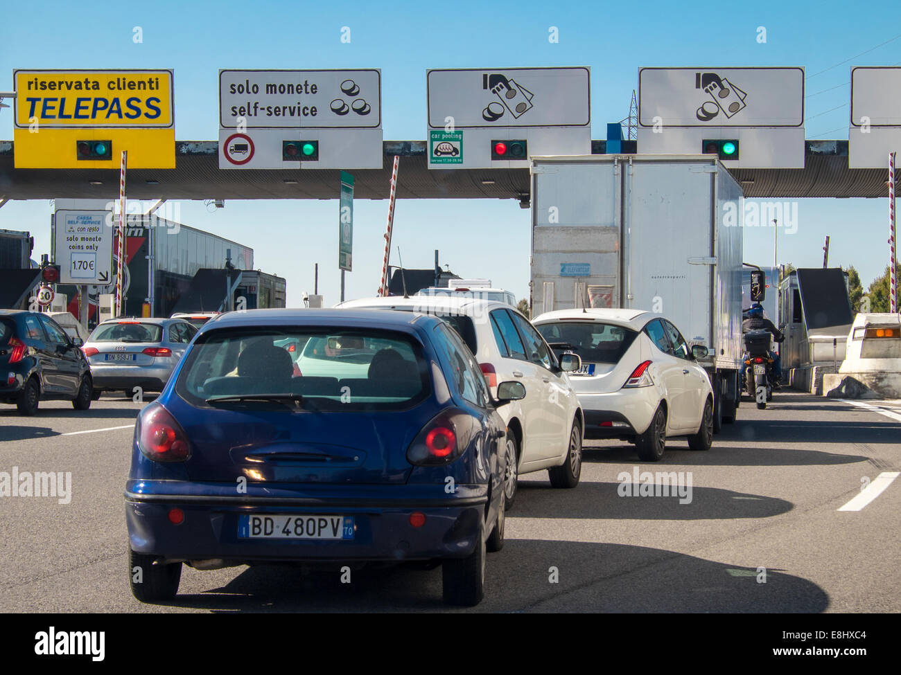 Vehicles queued at Italian autostrada toll booth - Stock Image