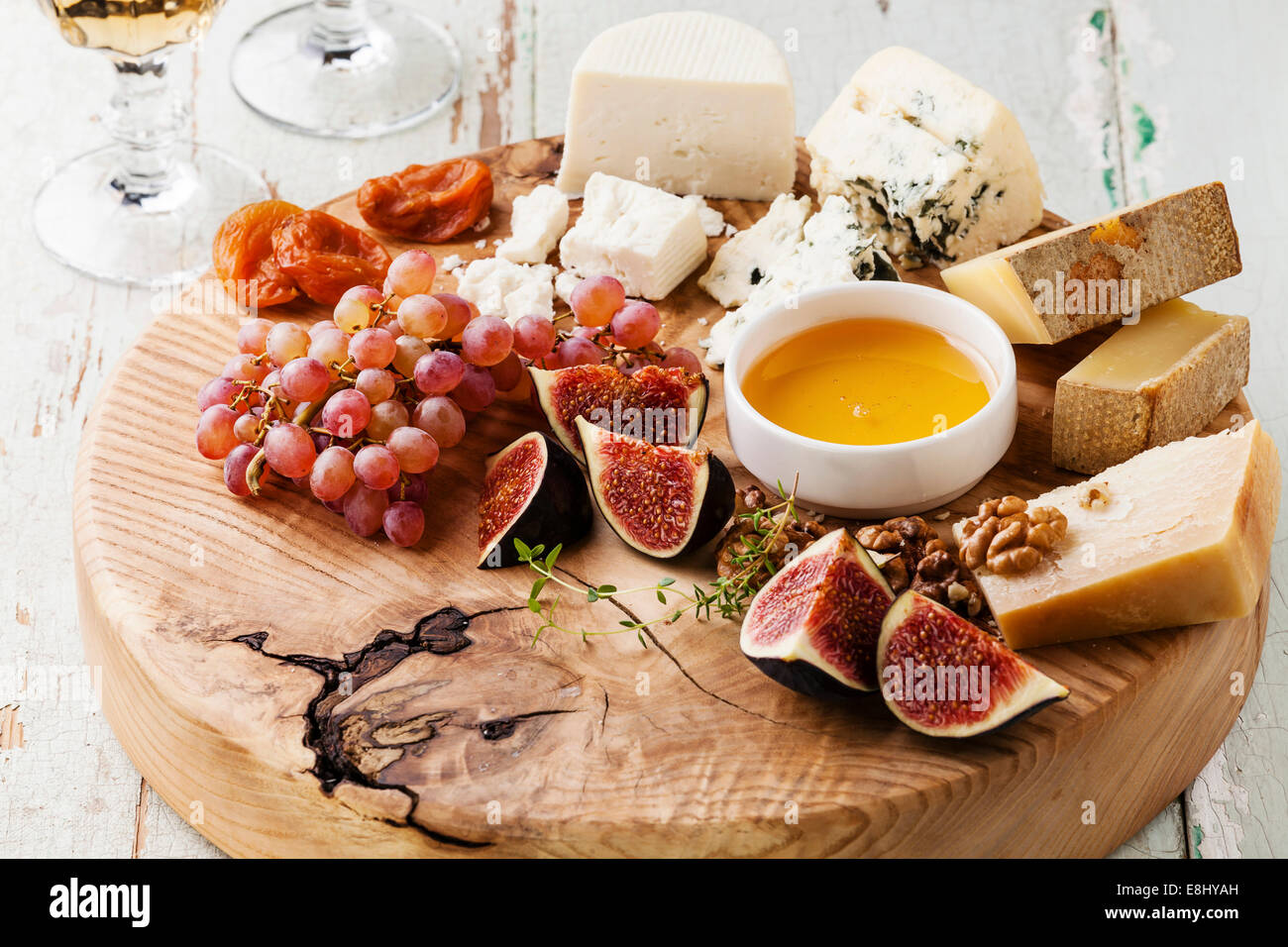 Cheese plate Assortment of various types of cheese on wooden cutting board Stock Photo