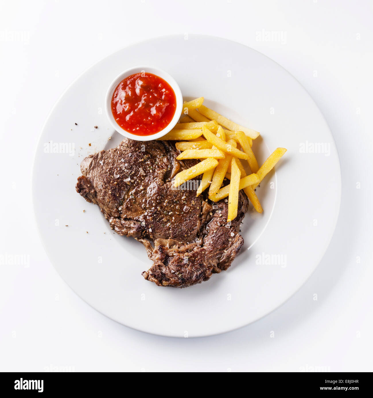 Roast beef with Salted french fries on white plate on white background - Stock Image