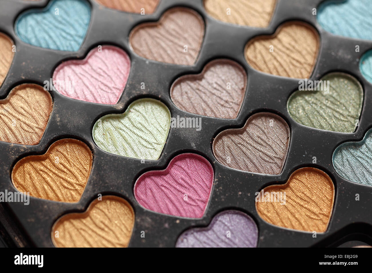Close-up of eyeshadow heart shaped palette. - Stock Image