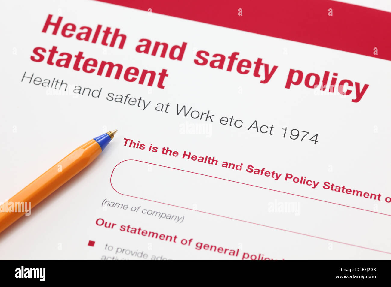 Health and safety policy statement and ballpoint pen. - Stock Image