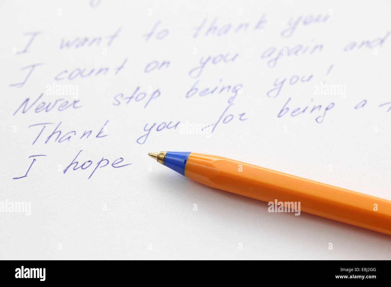 Writing letter to a friend. Close-up. - Stock Image