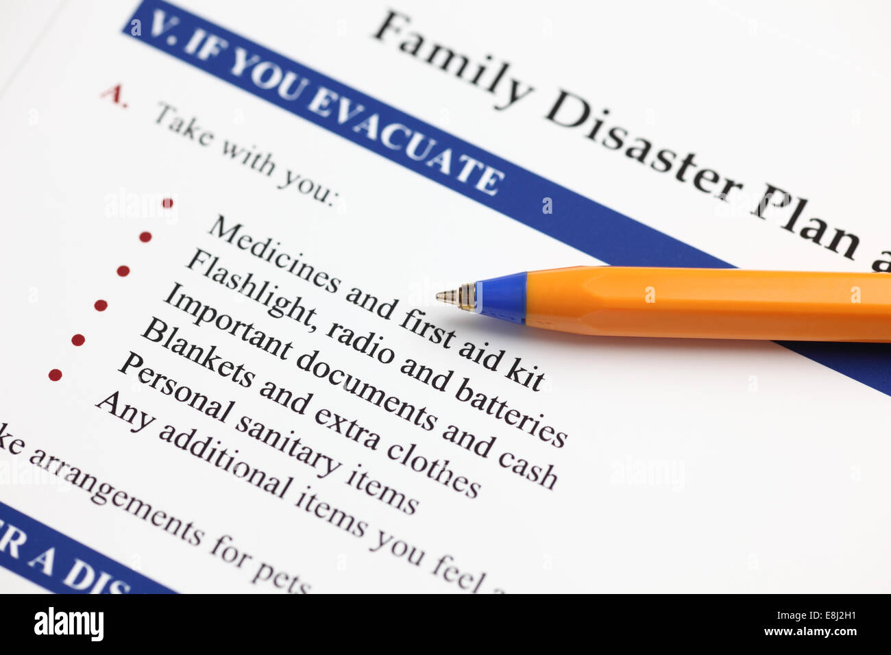 Family Disaster Plan and ballpoint pen. Close-up. - Stock Image