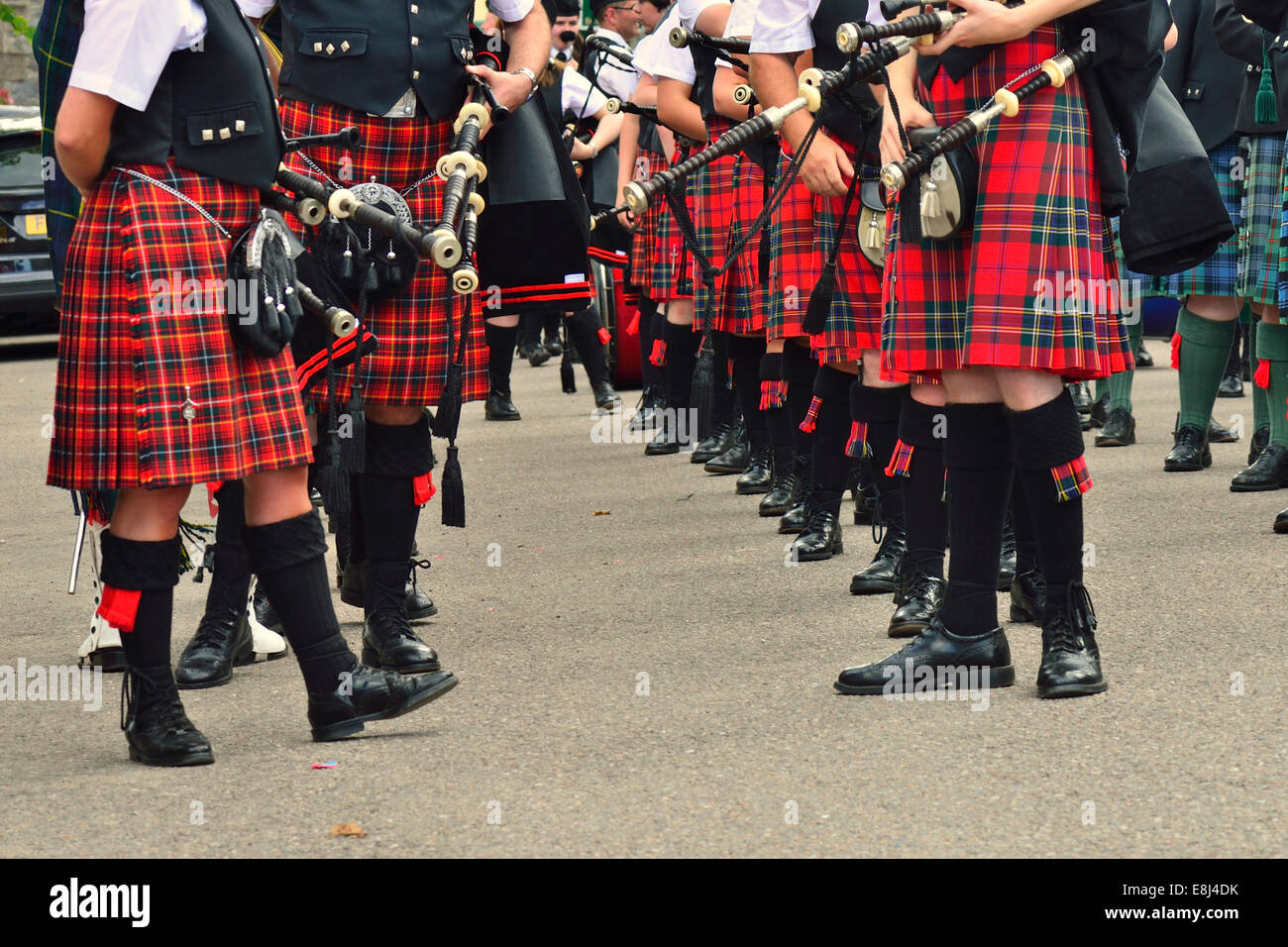 Members of a pipe band wearing kilts, with sporrans and bagpipes, before a performance, Dufftown, Moray, Highlands, - Stock Image