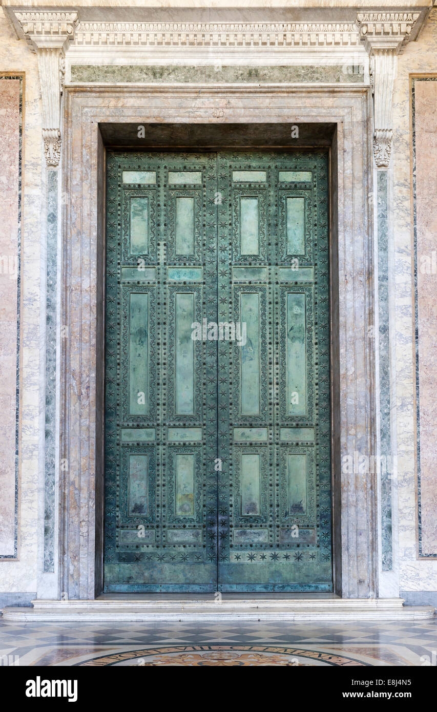 The bronze doors of the main entrance, originals from the Curia Iulia, Senate House in the Imperial Forum, basilica - Stock Image