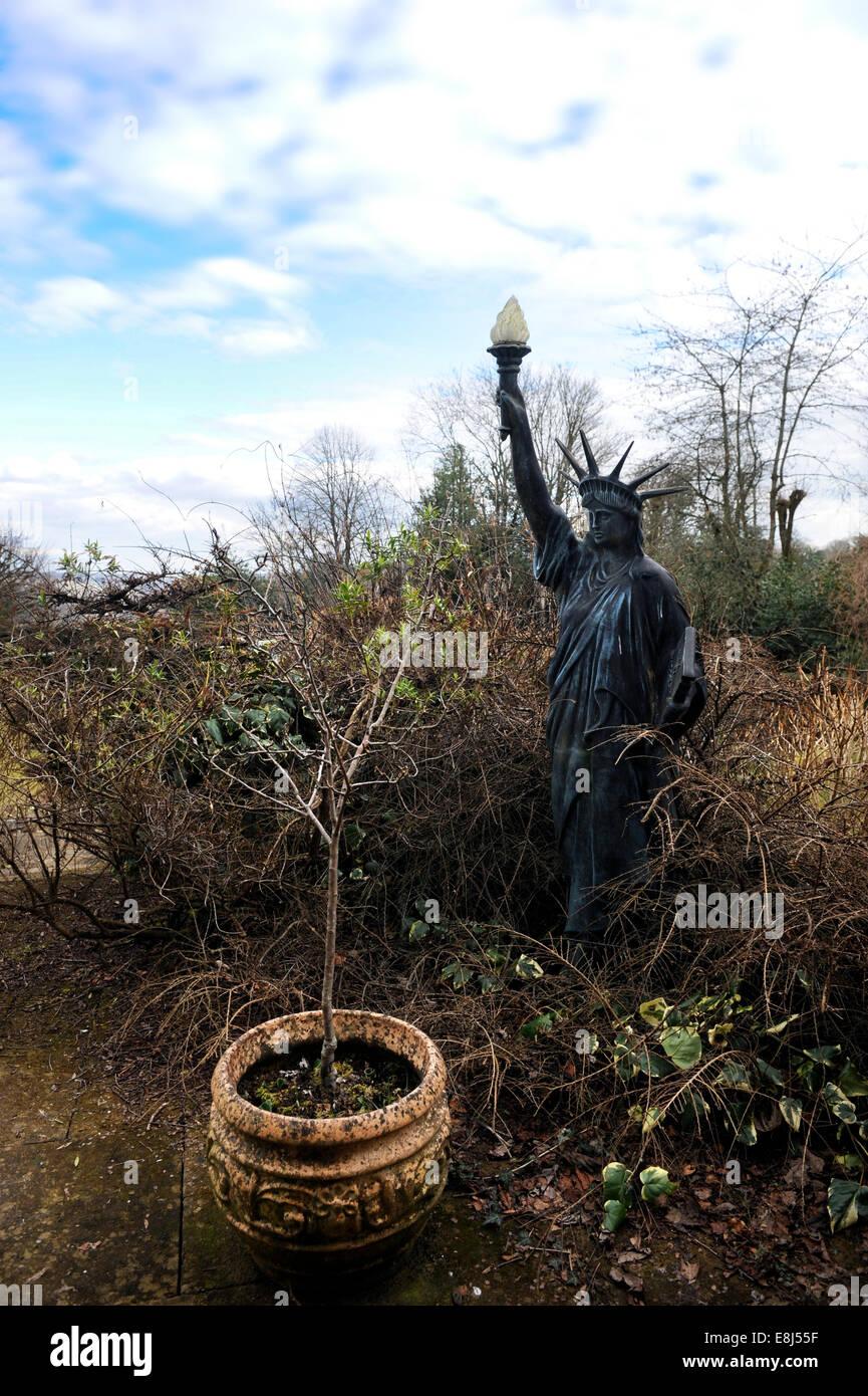 a statue of liberty garden ornament in an overgrown english garden uk stock image - Liberty Garden