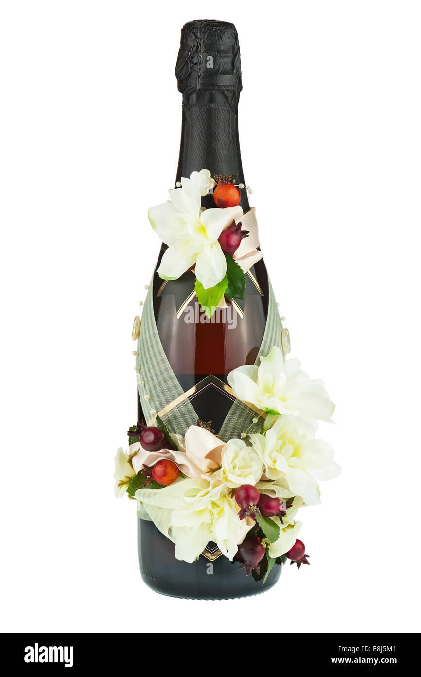 Champagne Bottle With Wedding Decoration Of Flower Arrangements