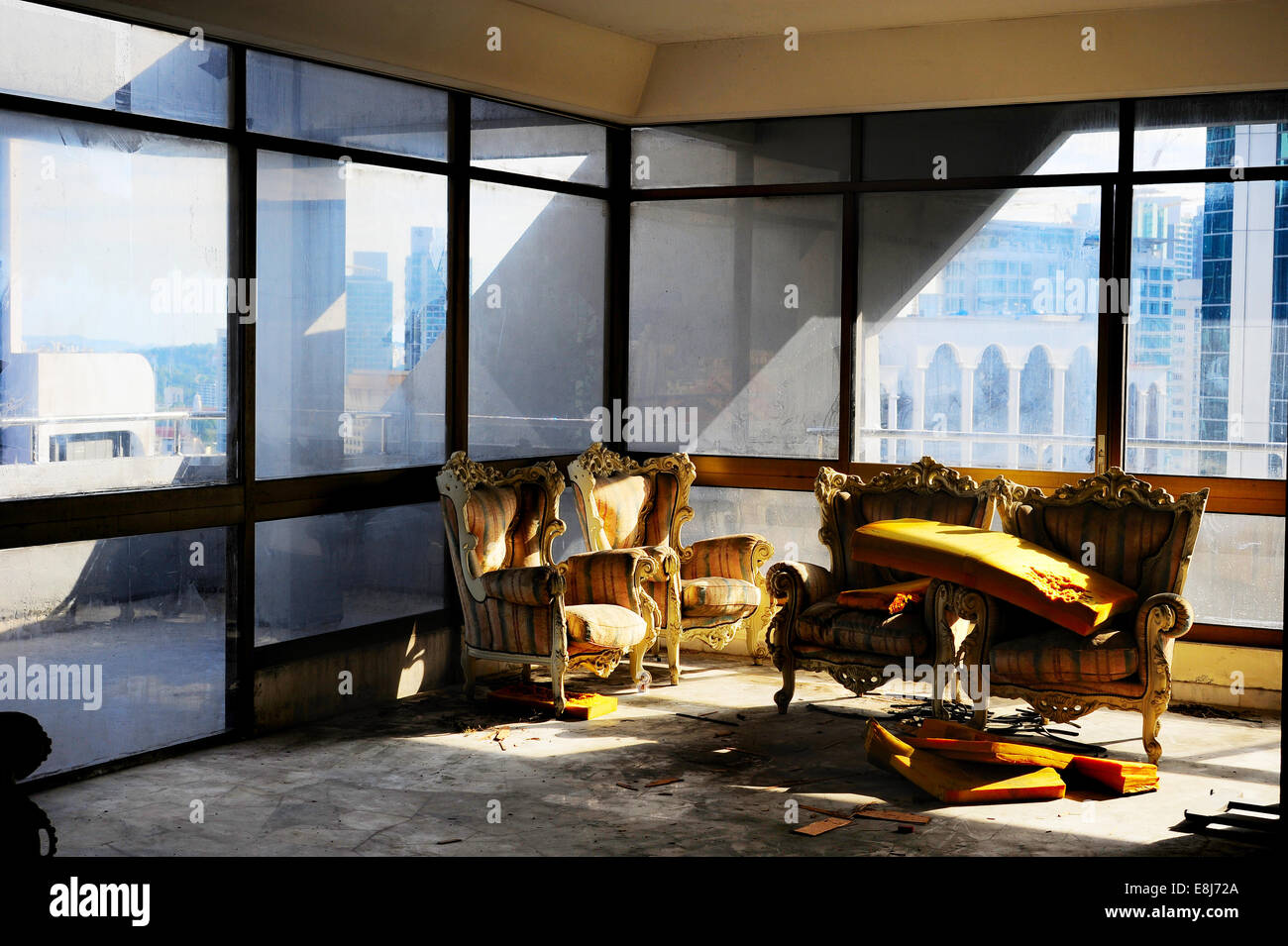 Abandoned house interior wit couch and chairs. Malaysia - Stock Image