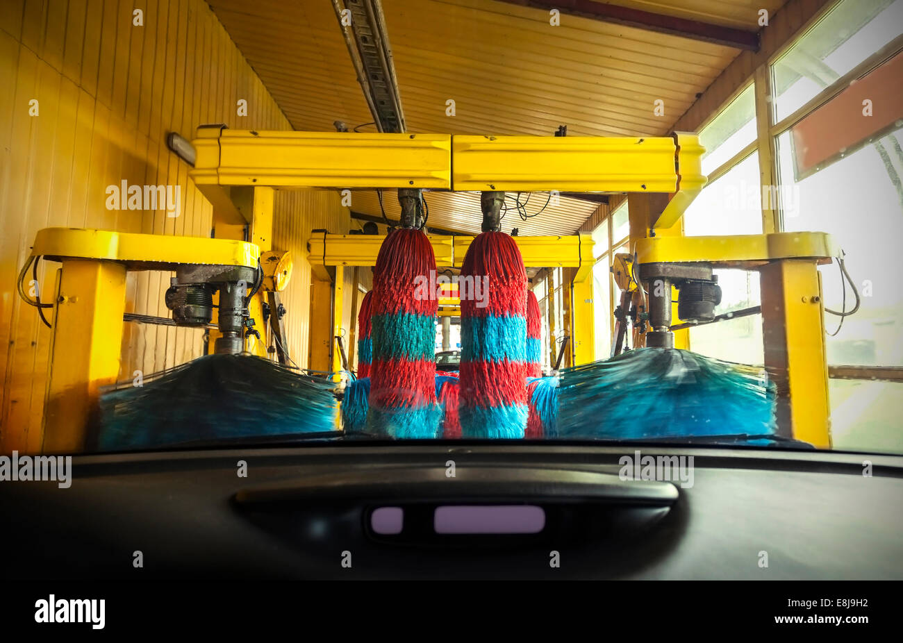 Car wash from inside a car during the wash. - Stock Image