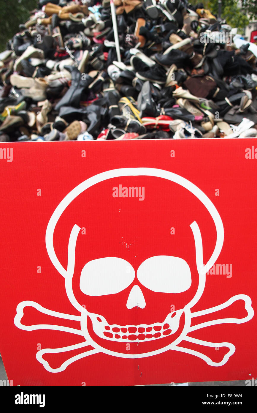 NGO Handicap International. Red skull and shoes. Symbolization of landmines injuries. - Stock Image