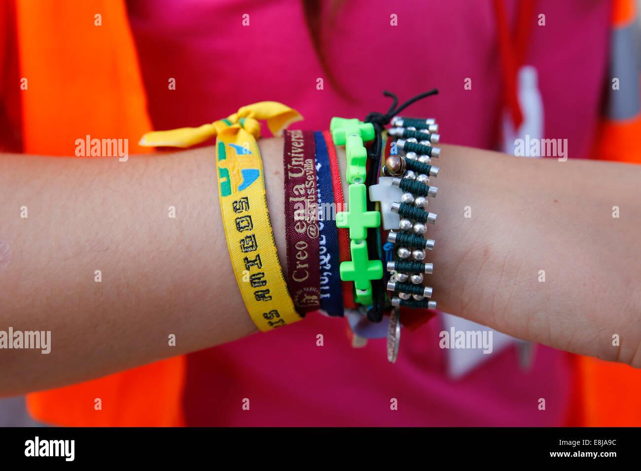 Young catholic pilgrim's wrist bands - Stock Image