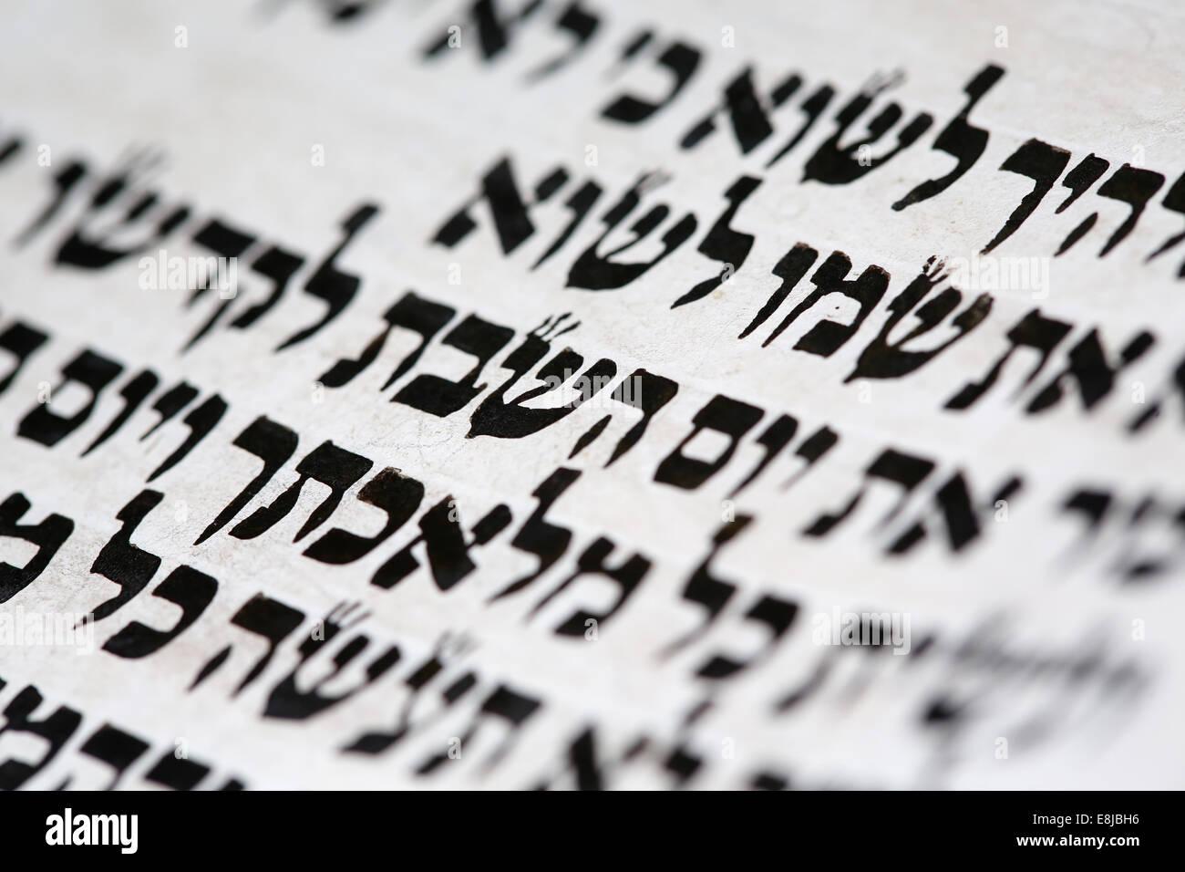 Jewish torah scroll. The word Shabbat in hebrew. - Stock Image