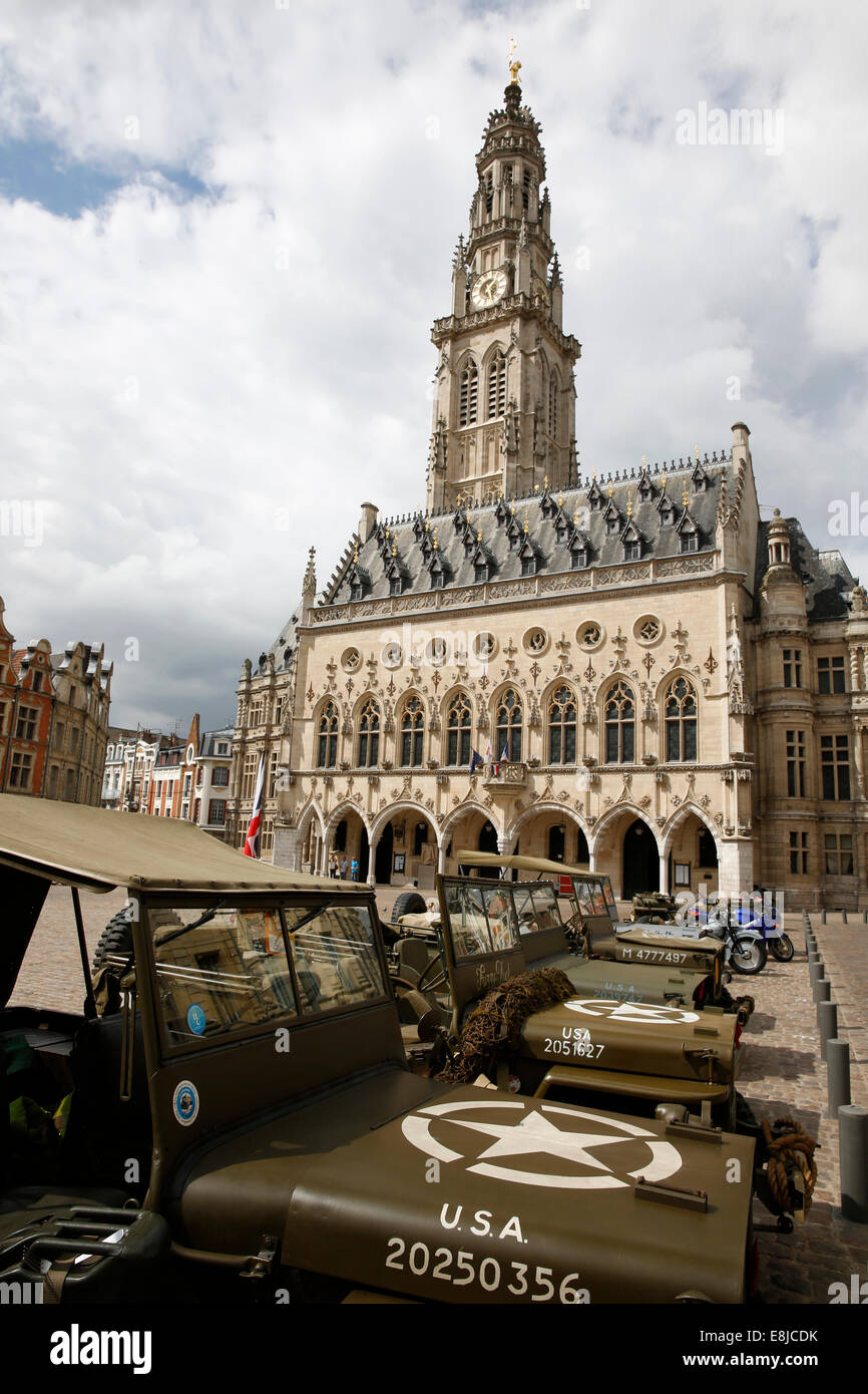 Former U.S. army Jeep in front of the city hall of Arras. - Stock Image