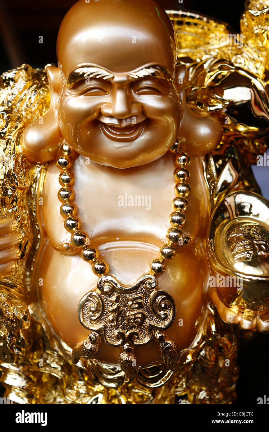 Statue of Ong Dia, the round, happy God of the Earth who symbolizes prosperity - Stock Image