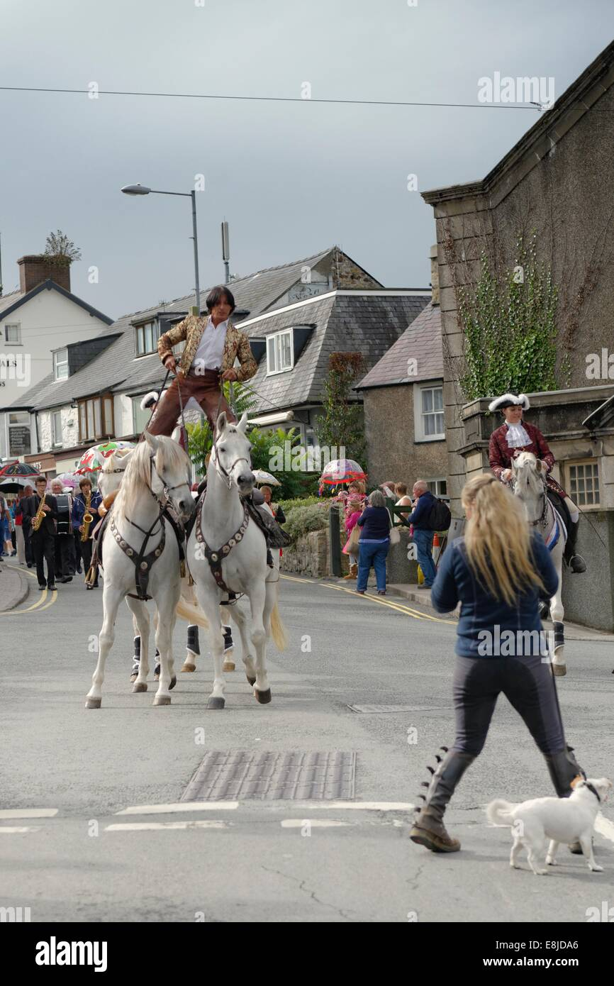 An equestrian riding two Lusitano dressage horses leads the opening procession of the Abersoch Jazz Festival 2014, Stock Photo
