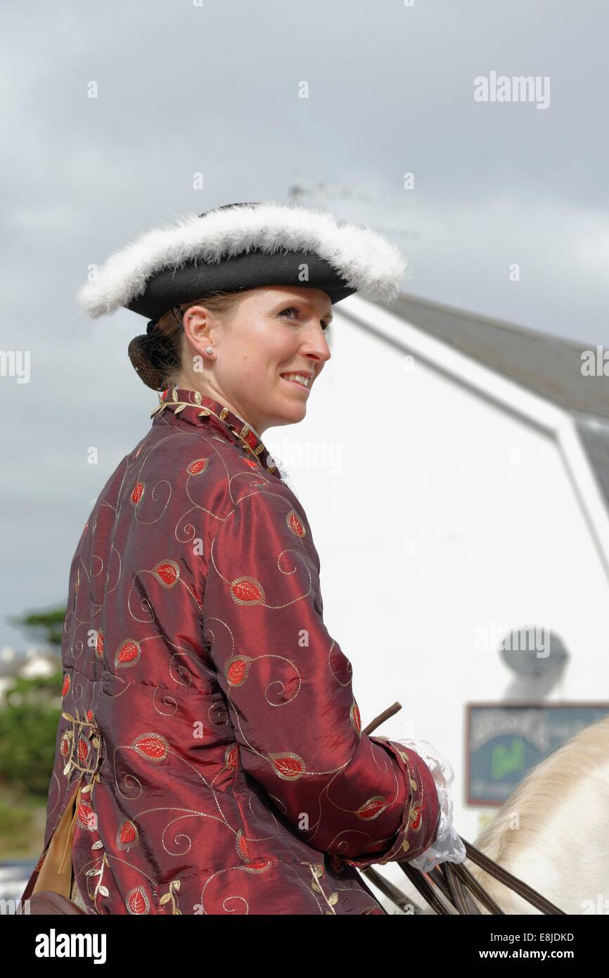 Lady rider  on her Lusitano horse in the opening procession that marks the beginning the Abersoch Jazz Festival - Stock Image