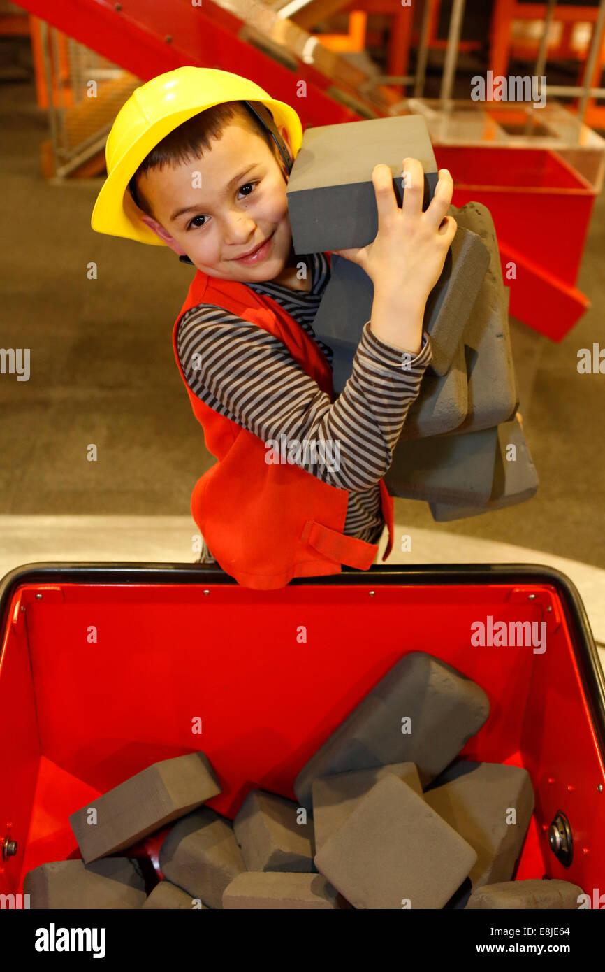 Boy having fun and educational activities at la CitŽ des Sciences, Paris - Stock Image