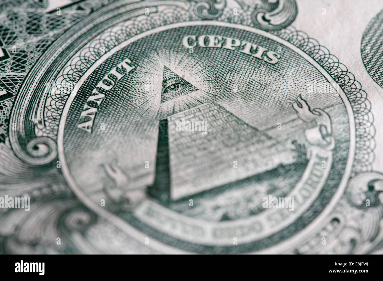 The reverse of the United States one-dollar bill depicting a Pyramid with 13 steps and the Eye of Providence. - Stock Image