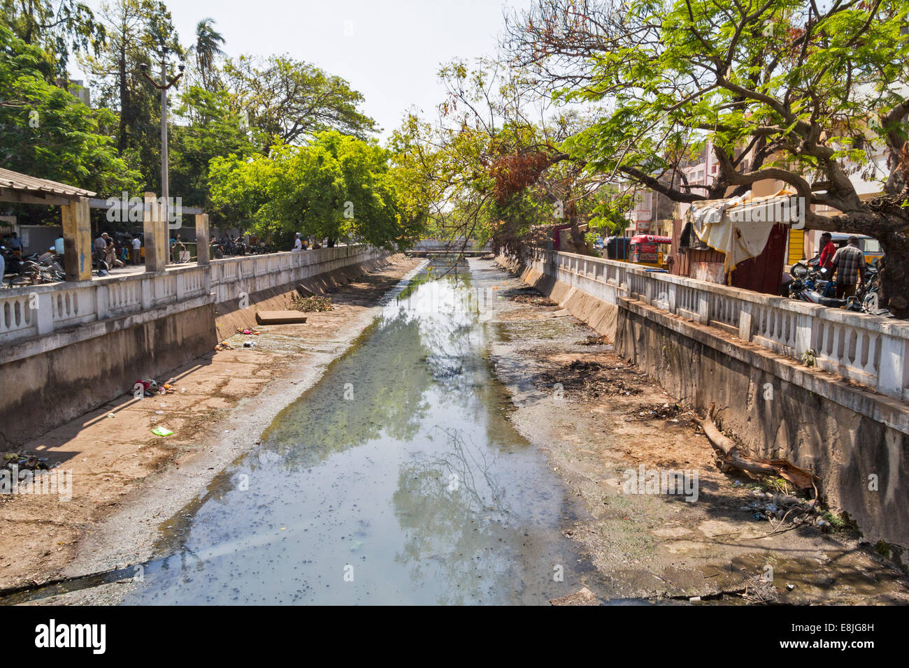 PONDICHERRY INDIA TREE LINED STREETS AND SEVERELY POLLUTED STINKING CANALS OR OPEN SEWER  IN THE CENTRE OF THE TOWN - Stock Image