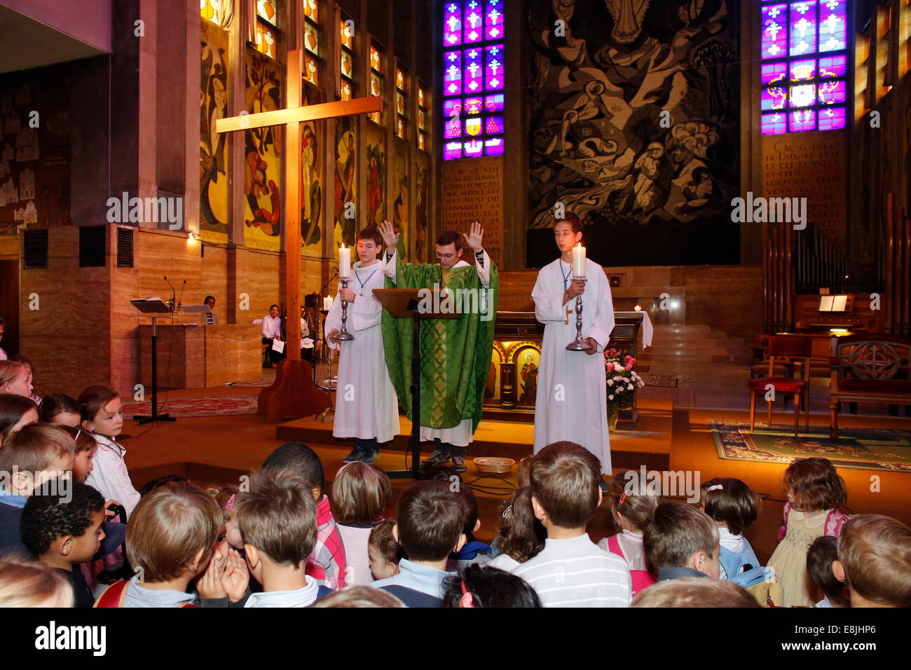 Mass of the new term at St Joan of Arc's school. Blessing of the pupils. - Stock Image