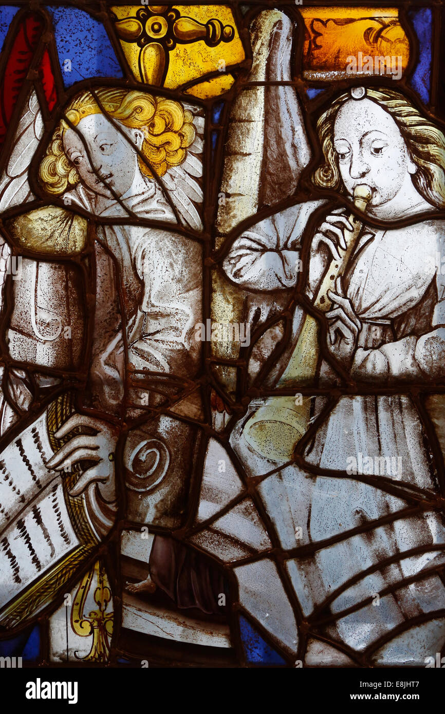 Saint SŽverin church's fragments of stained-glass window from the XVth and XVIth century. Musicians angels. - Stock Image