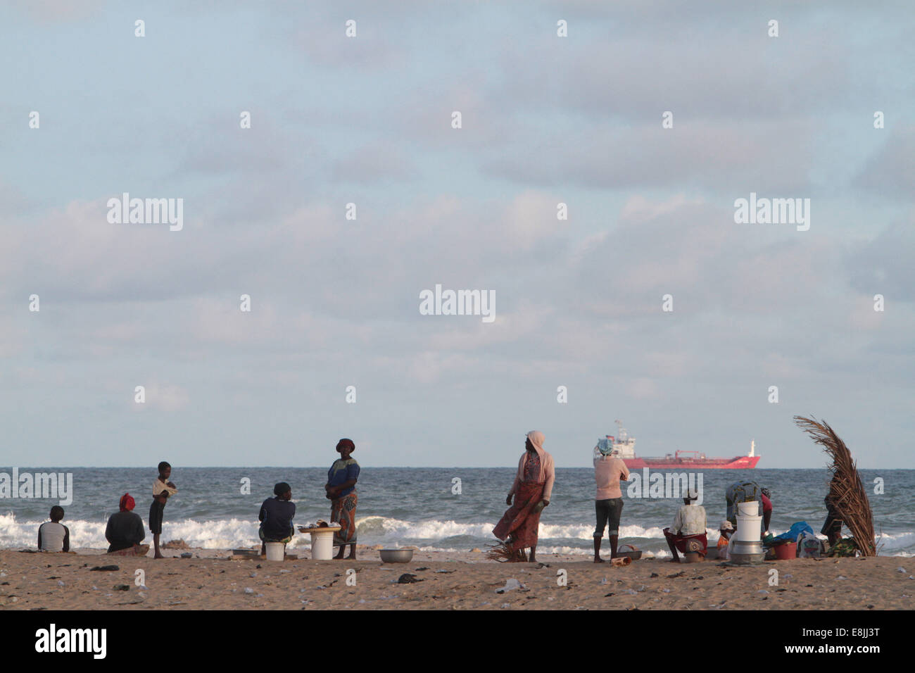Africans on the beach. - Stock Image