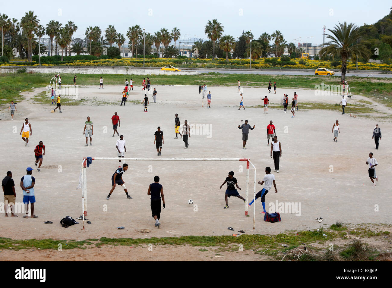 West Africans playing soccer in Tunis - Stock Image