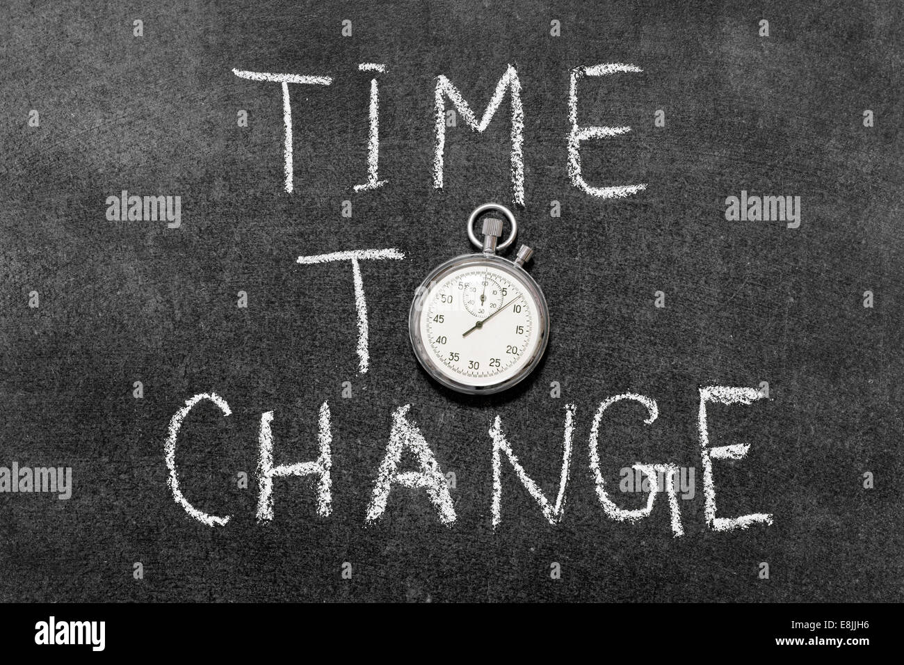 time to change concept handwritten on chalkboard with vintage precise stopwatch used instead of O - Stock Image