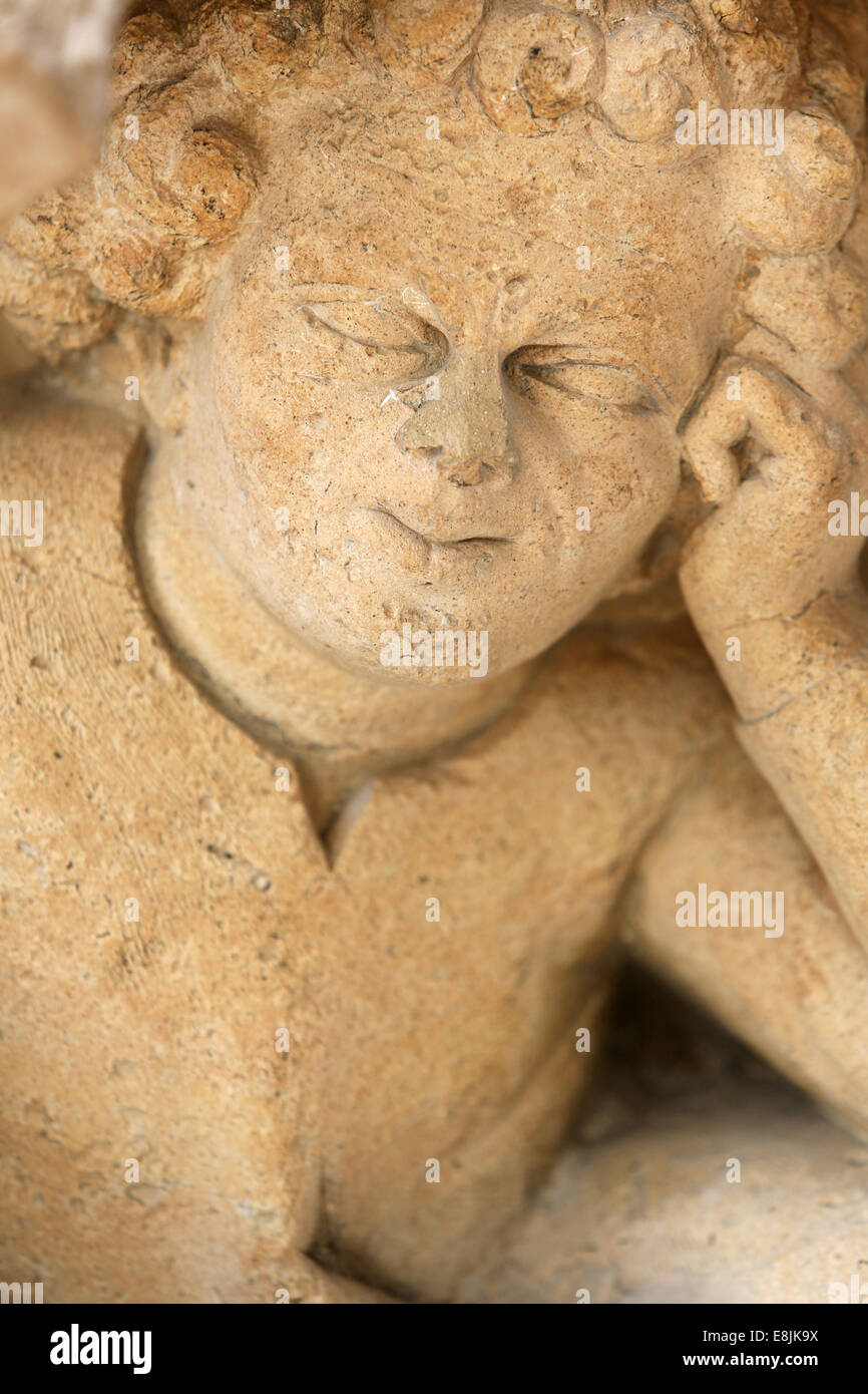 Angel thinker. Notre-Dame de Reims Cathedral. - Stock Image