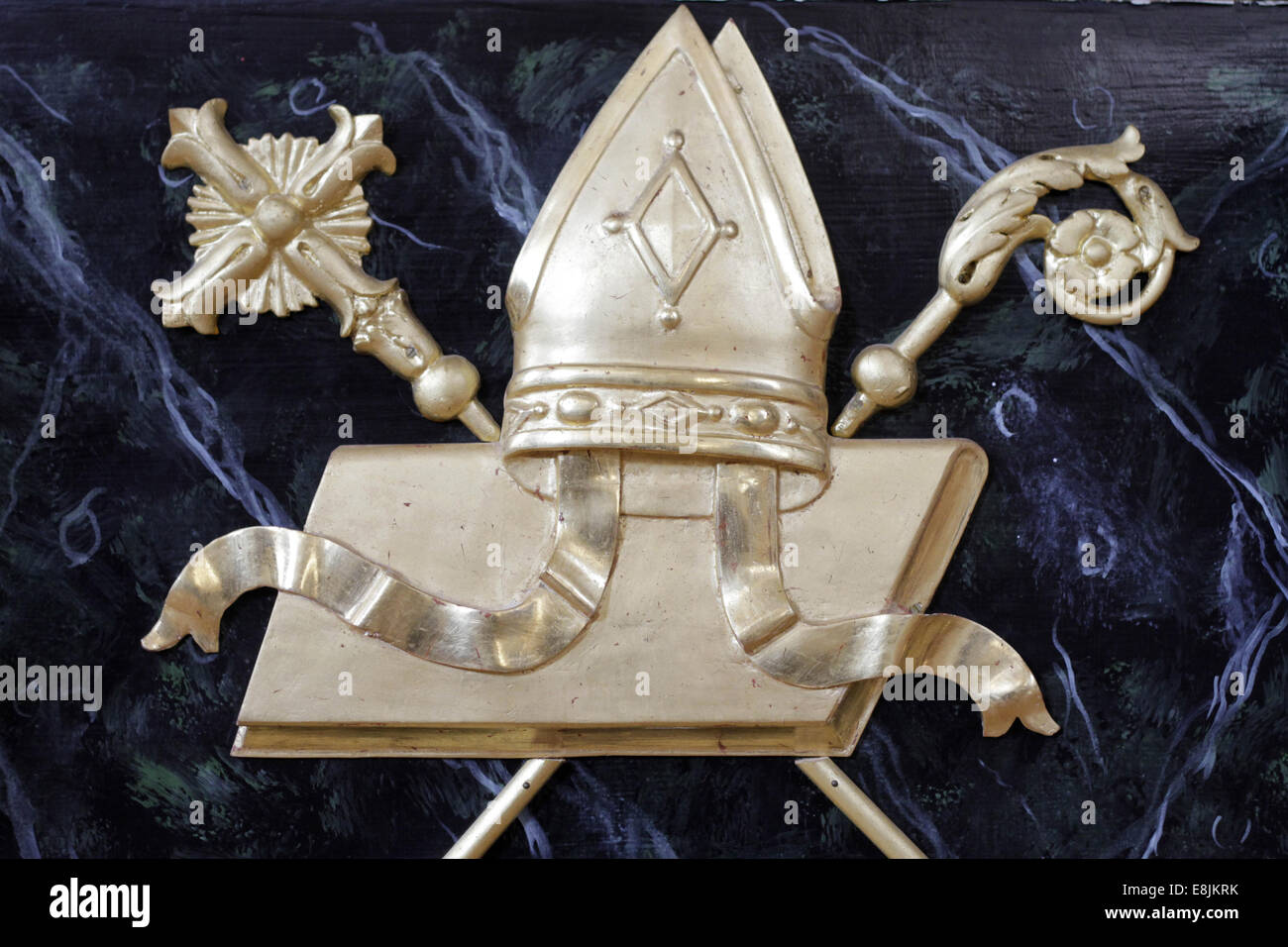 Symbols of the bishop : miter, crozier and gospel. Stock Photo