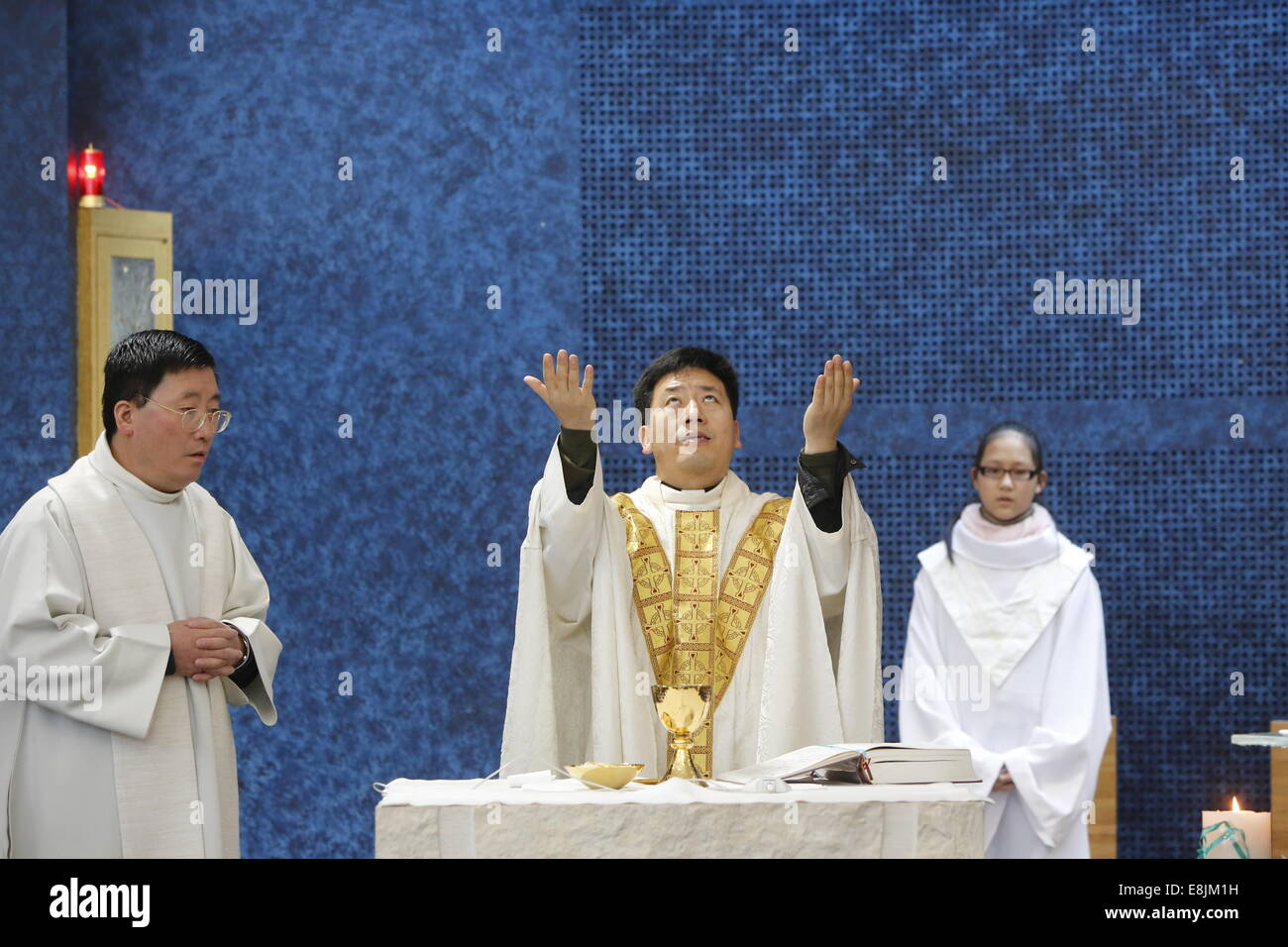 Sunday mass in Notre Dame de Chine church - Stock Image