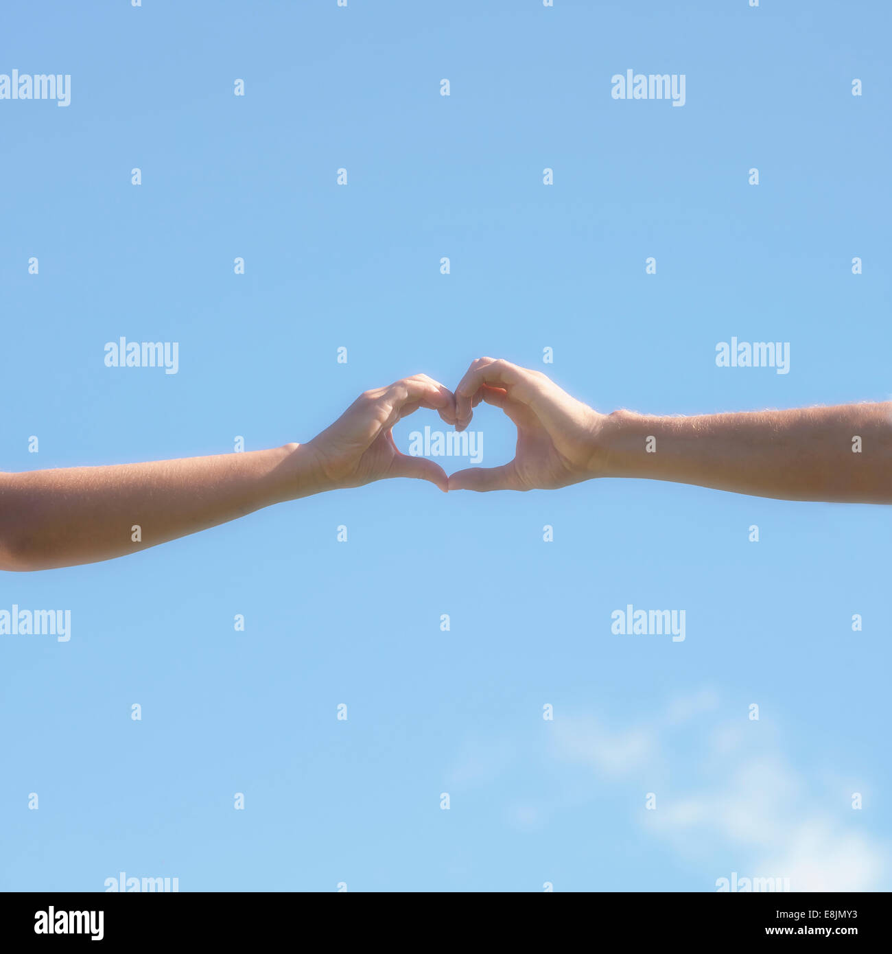 two hands forming a heart - Stock Image