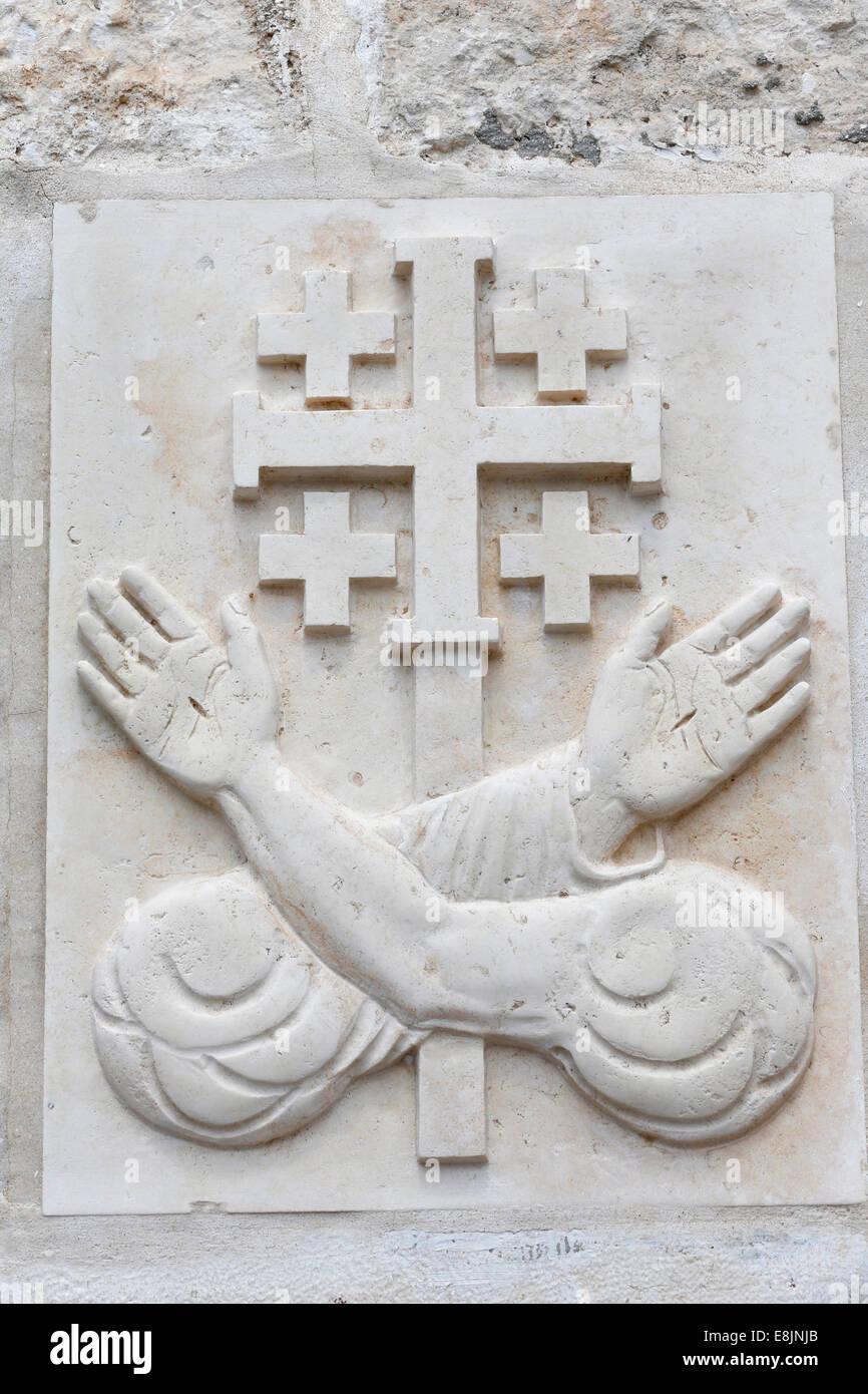 Emblem of the secular franciscan order. - Stock Image