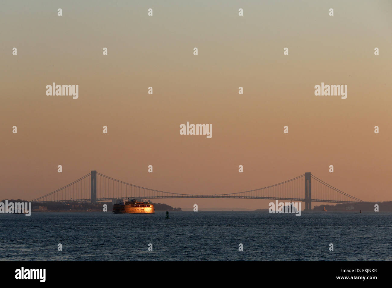 Ferry and Verrazano-Narrows Bridge Spanning Upper New York Bay. - Stock Image