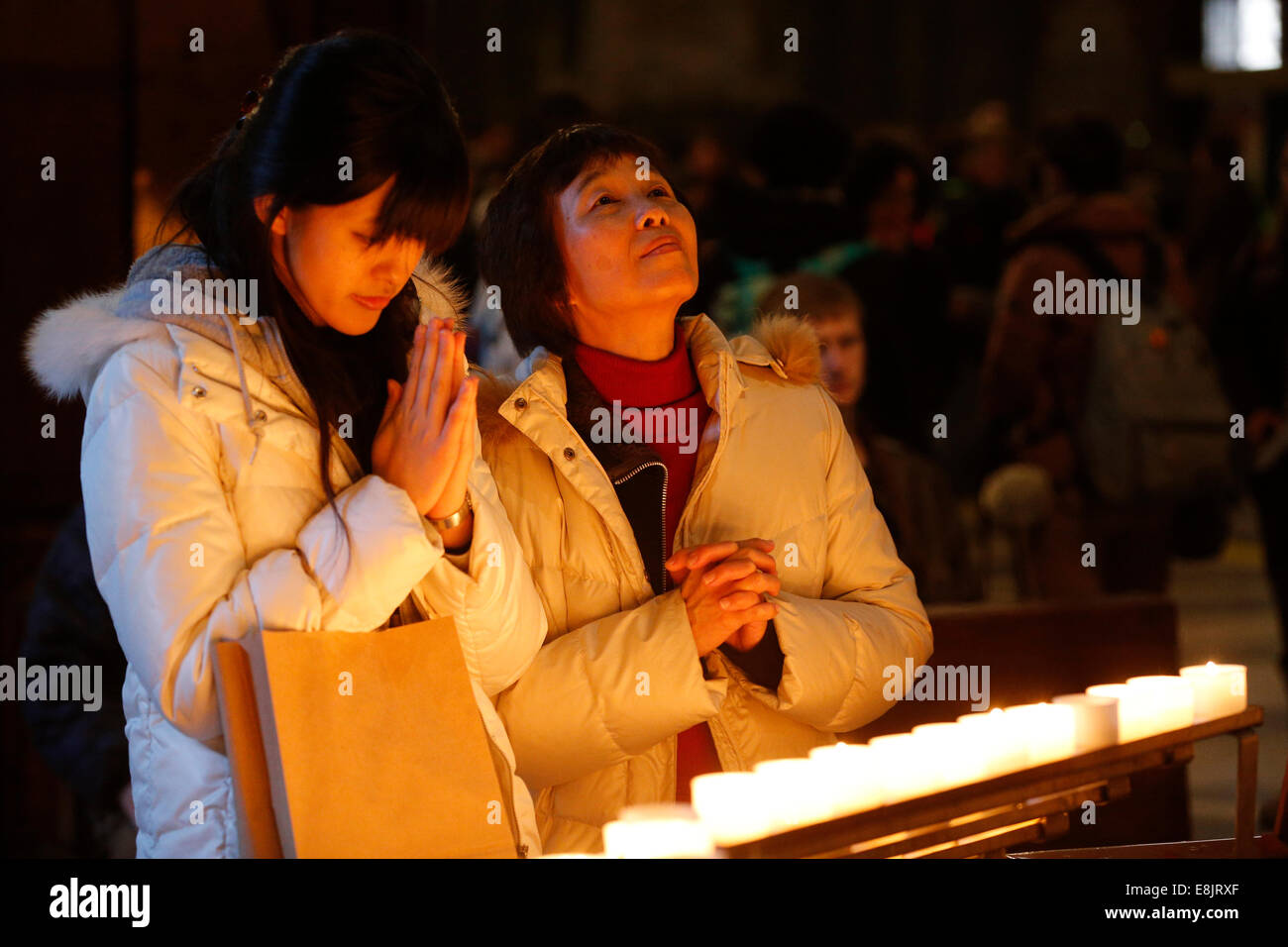 Candles church. Young Christians in a church. - Stock Image