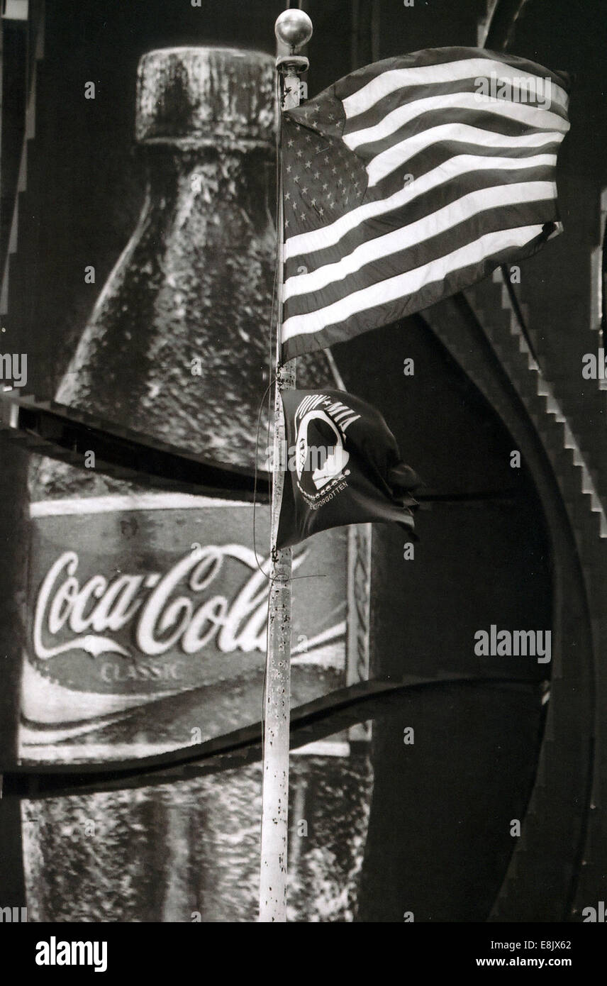 Coca Cola advert and American flag in New York city - Stock Image