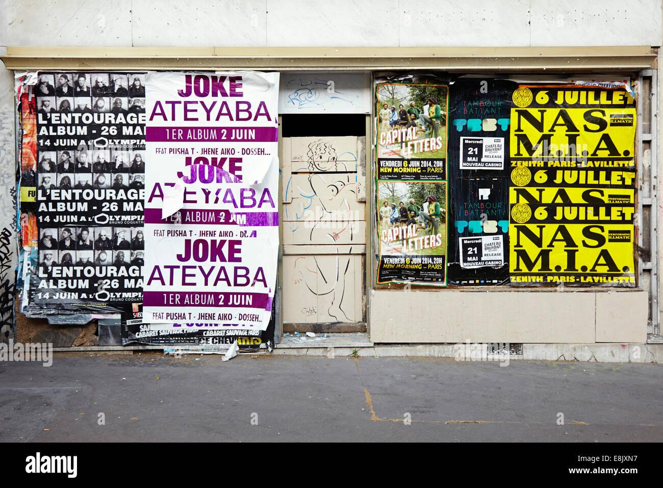 Posters and doorway in Paris - Stock Image
