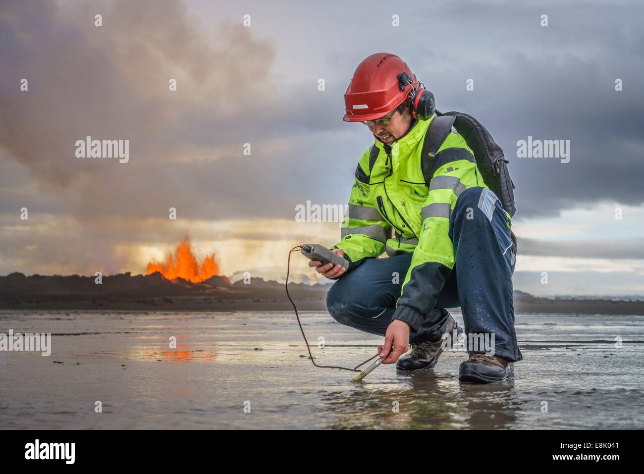 Scientist taking measurements by the eruption site at Holuhraun, near the Bardabunga Volcano, Iceland. - Stock Image