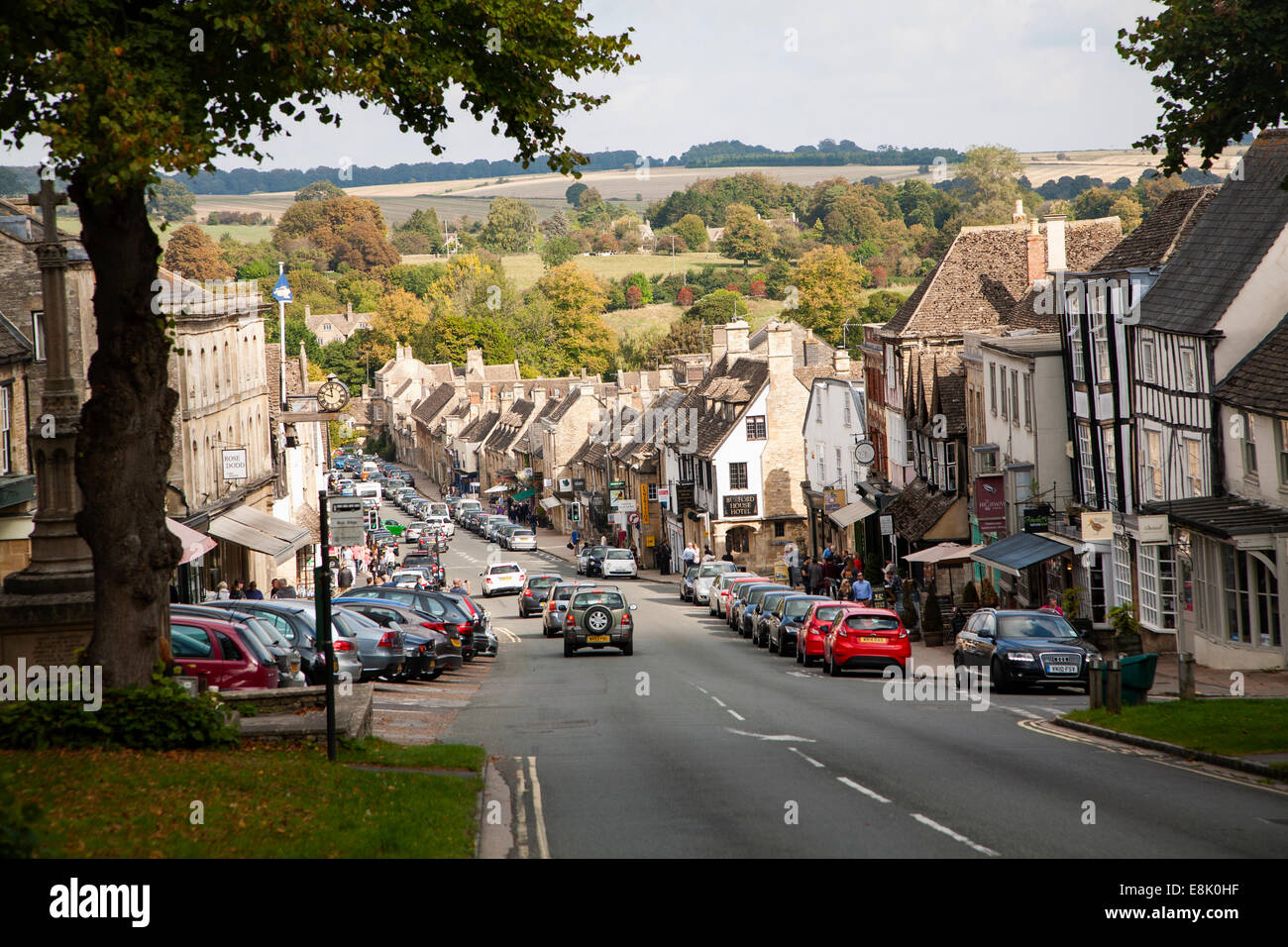 Tourist honeypot village street crowded with traffic in Burford, Oxfordshire, England, UK - Stock Image