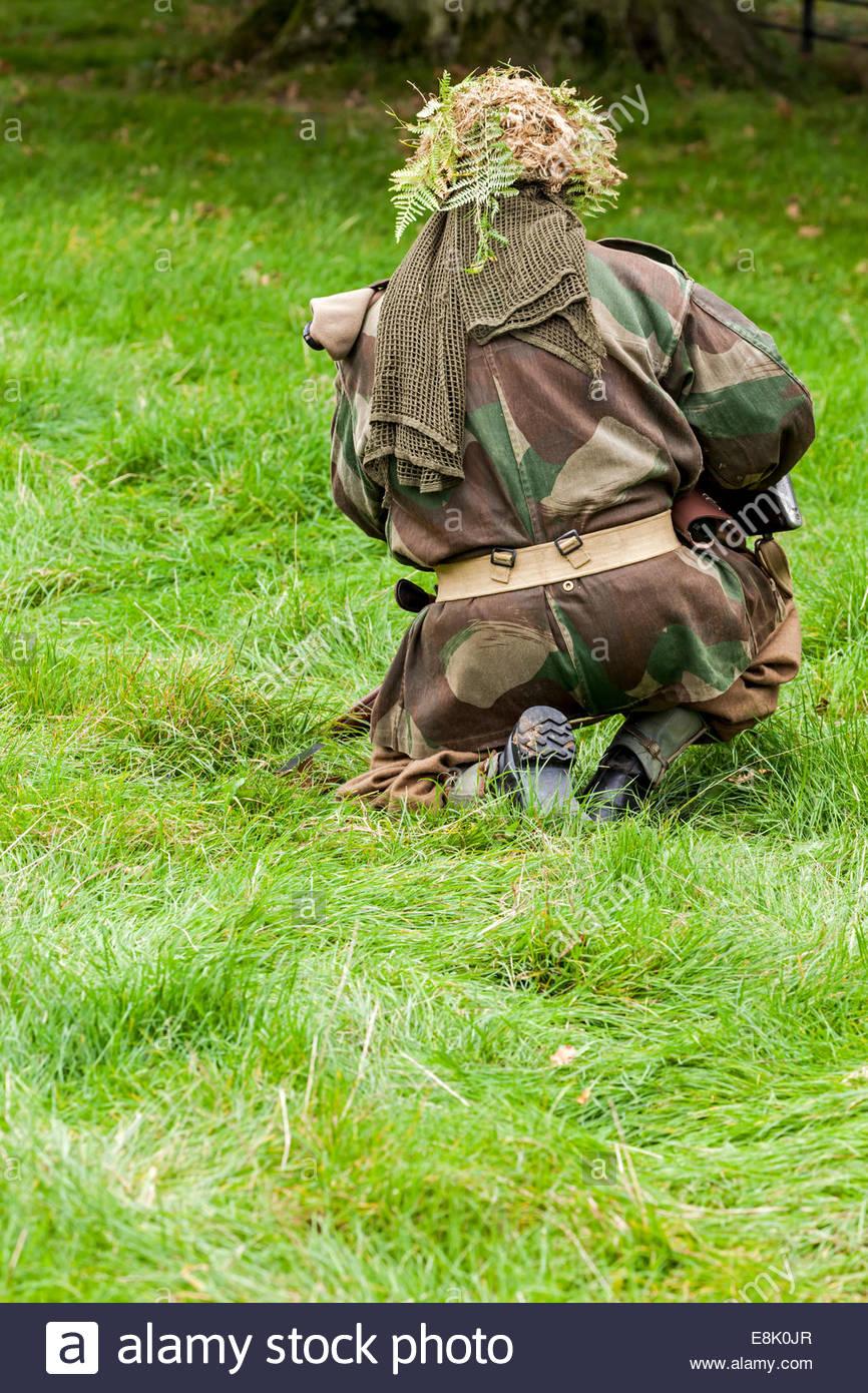 WW2 re-enactor.  Paratrooper in camouflage uniform - Stock Image