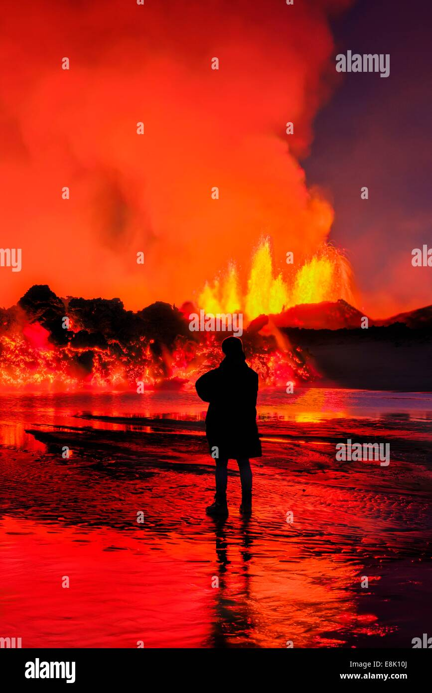 Woman watching the lava flow at the Holuhraun Fissure eruption near the Bardarbunga Volcano, Iceland - Stock Image