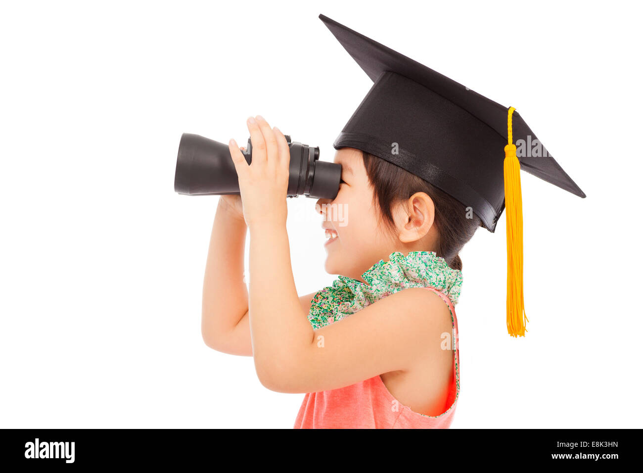 happy asian Little girl looking through binoculars. isolated on white background - Stock Image