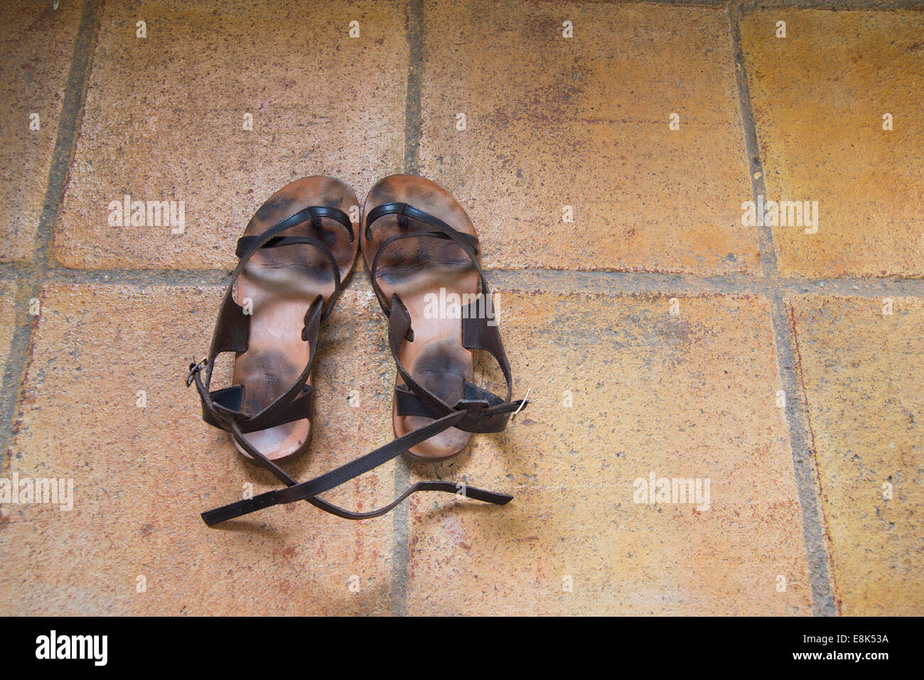 Pair of old sandals. - Stock Image