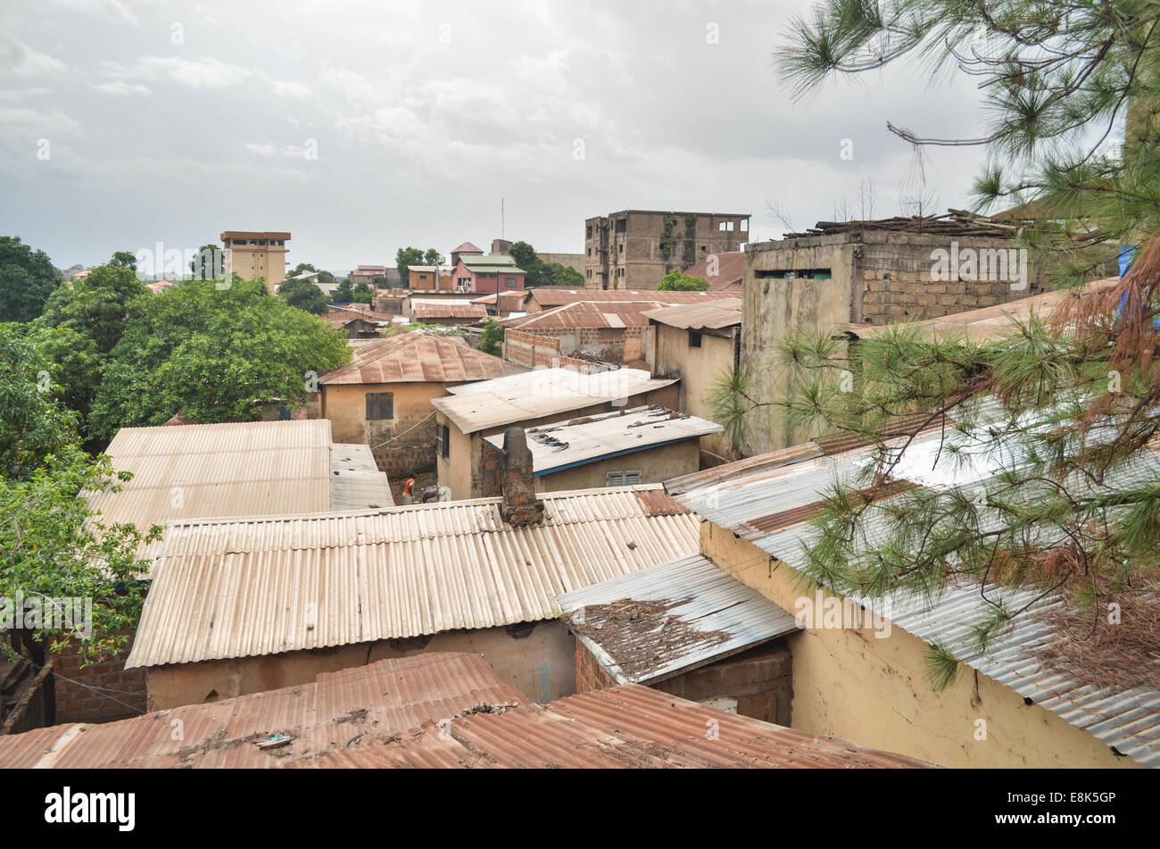 Rusty old roofs of the city center of Labe, Guinea - Stock Image