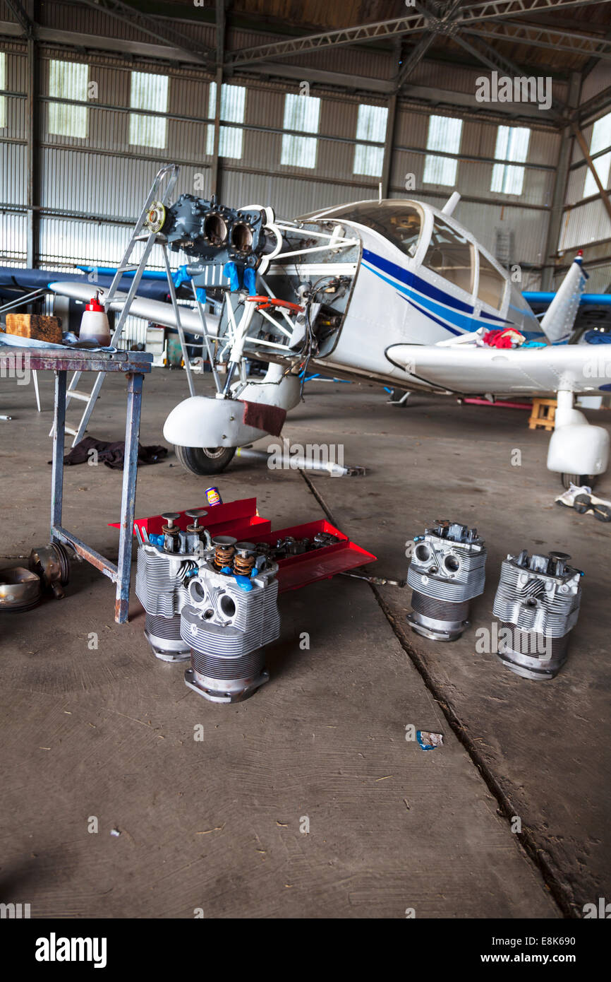 engine being worked on a Piper PA 28 plane light aircraft barrel piston dismantled in bits repair repairing  apart - Stock Image