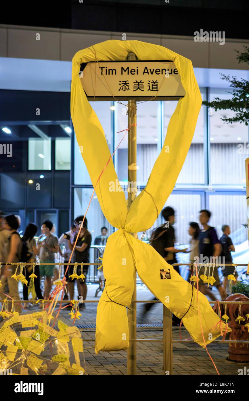 Yellow ribbon tied at the road sign - Stock Image