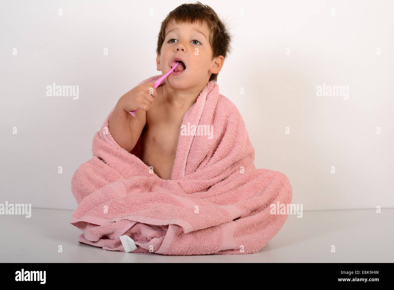 Young boy child children cleaning brushing teeth - Stock Image