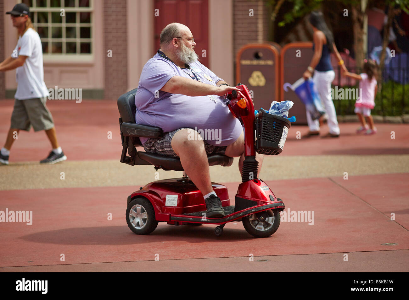 Florida USA Disneyland Fat person on a mobility scooter ...