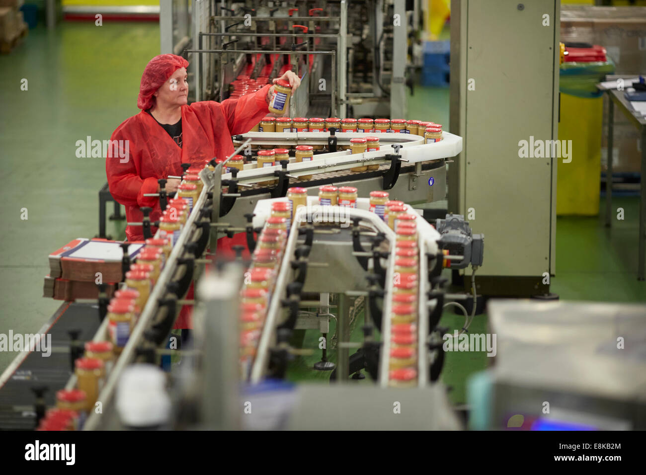 Peanut Butter Manufacturing production plant line in the family business factory floor of Duerr's Jams warehouse - Stock Image