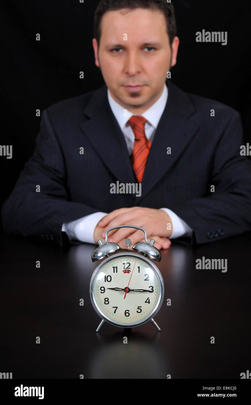 Businessman is waiting for meeting on the black background - Stock Image